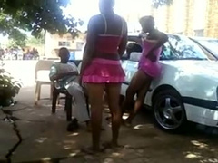 Black prostitute gives a naughty public lap dance