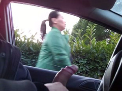 Sitting in a parked car and masturbating cock