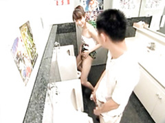 Sweet Japanese girl peeing at the urinal with her boyfriend