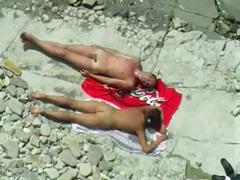 Russian couple alone on the rock beach has hardcore sex