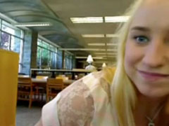 Shy girl toys her pussy in the library