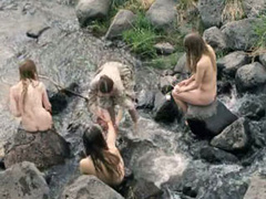 Naked mermaids in the river get their feet washed