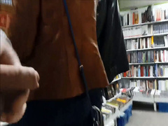 Stroking cock next to two girls in the store