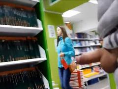 Masturbating his boner to a pretty college girl in the store