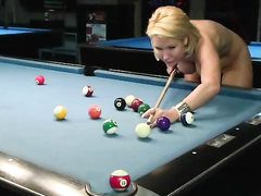 Naked babes play a game of competitive pool