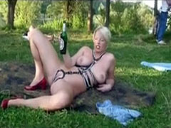 Kinky blonde mom has a creampie gangbang in the park