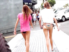 Lovely bikini girls walking down the street