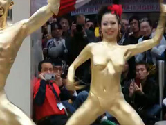 Body painted Thai ladies dance in public