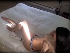 Busty amateur masturbating with a toy