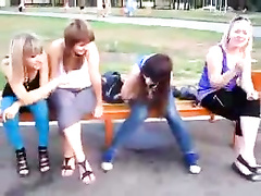 Naughty Russian girl pees through her jeans on public bench