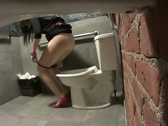 Bridesmaid in heels taking a pee in the restaurant toilet