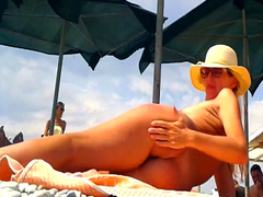Blonde wife with a gorgeous body on the beach