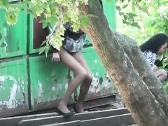 Ukrainian ladies in pantyhose caught making water by a dumpster
