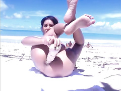 Bikini cutie plays with a dildo during beach webcam show
