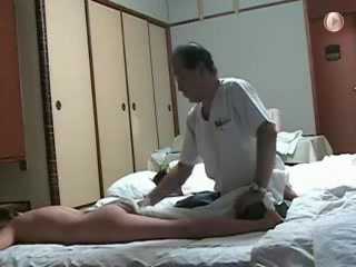 My naked wife gets massage from an Asian man