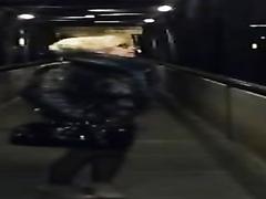 Horny woman pisses on the bridge