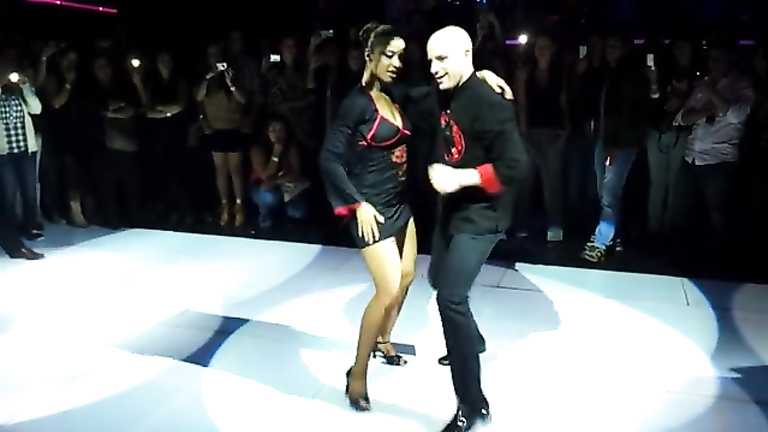 Latin couple dances in public for a big audience