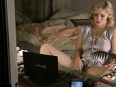 Cute blonde angel flicks her clit to an erotic scene on her computer