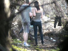Skinny girl pees in the woods with her boyfriend