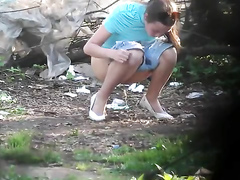 Young Ukrainian lady goes pee outdoors and gets filmed