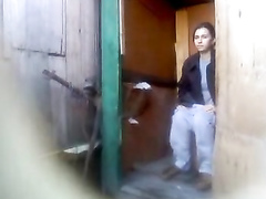 Russian amateur lassie piddles with the door open