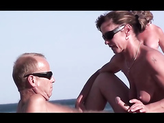 Nude beach blowjob and handjob for a happy hubby