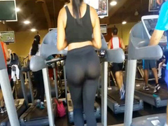 Big sporty ass in nearly sheer tights at the gym