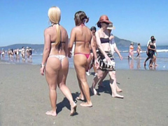 Filming bikini girls with hot butts on the beach
