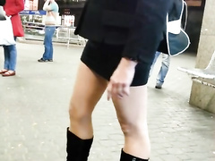Sexy girlfriend in short dress and boots