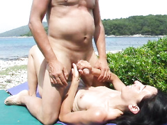 Mature couple films coitus on the beach