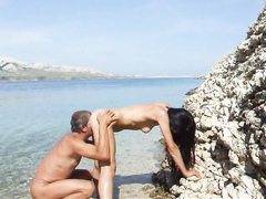 Amateur doggystyle sex in the sea