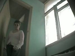 Russian teacher in a sweater pees in the women's WC