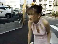 Asian woman pooping her pantyhose in public