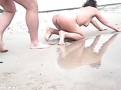 Quick doggystyle sex on the beach with my wife