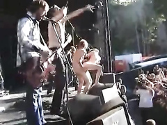 Hippies copulate on stage at a rock concert