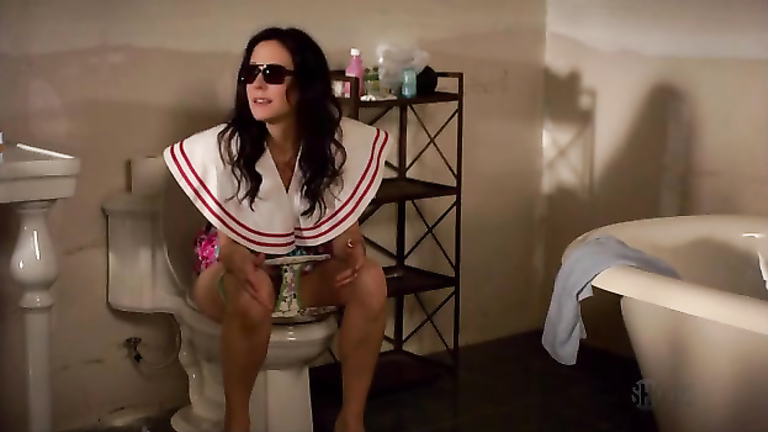 Mary Louise Parker on the toilet