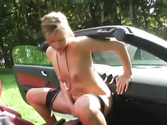 German girl in stockings squirts on the car gear shift