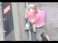 Couple has a quick doggystyle sex on a public street