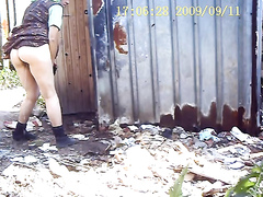 Nice ass on a mature lady pissing outdoors