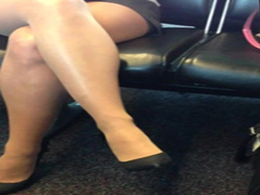Charming lady with smoking hot legs at the airport