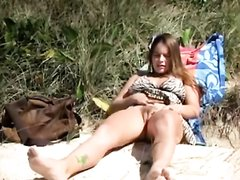 Hairy girl masturbates to orgasm on the beach
