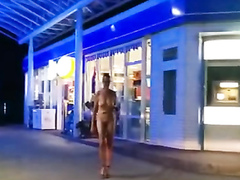 Naked slave in a collar shops at a convenience store