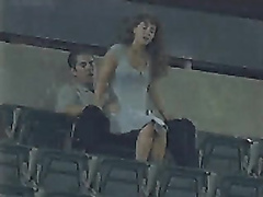 Horny friends make love in the high seats of the stadium