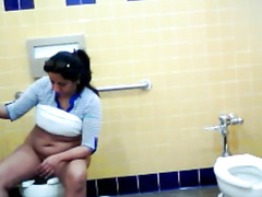 Thick Mexican woman piddles and washes her genitals in the restroom