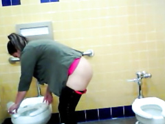 Curvy mommy urinates in the public WC