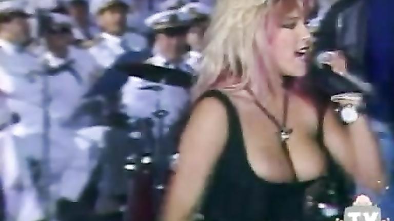 Samantha Fox nipple slip during a concert