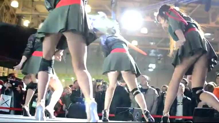 Short pleated skirts and heels on sexy dancing girls