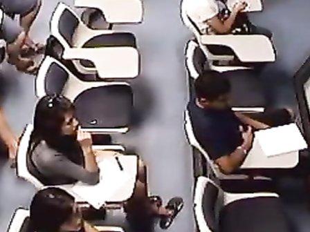 Pretty feet of Asian girls in class