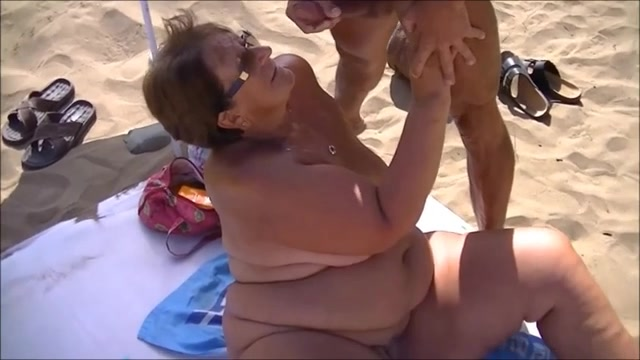 Stranger ejaculates on my beautiful wife at the beach