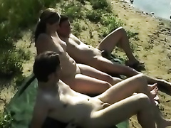 Two guys banging her by the river